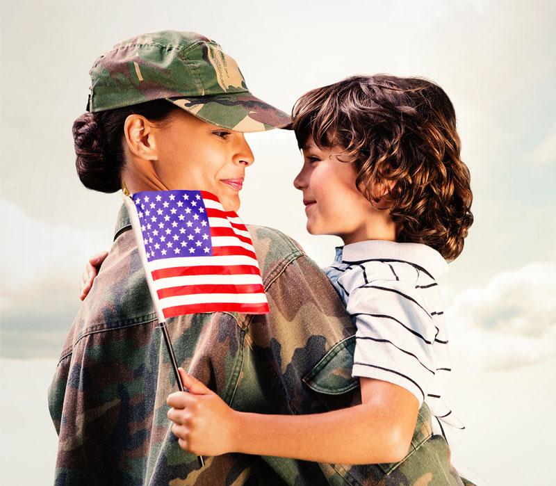 Veteran hugging daughter after arriving back home